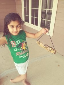 Lower School student makes bird feeder at home learning