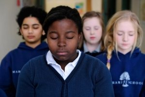 students meditate and release stress