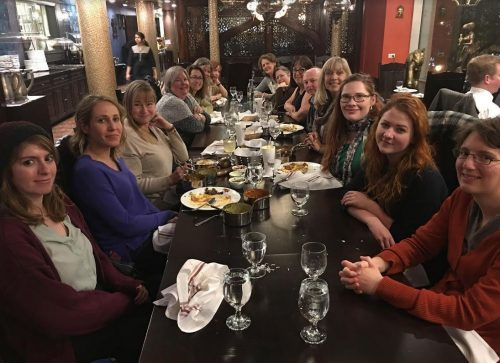 Maharishi School Iowa private day and boarding school faculty enjoy dinner together at the Independent Schools Association of Central States Conference, 2017.