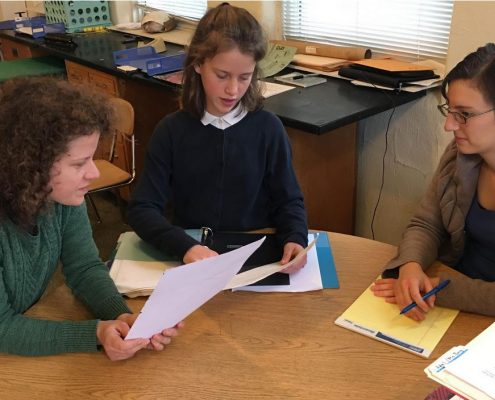 Maharishi School Iowa day student has a student-led conference with her mother and teacher.