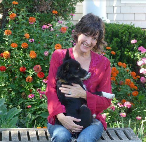 Maharishi School Director of Enrollment Managment Carol Chesnutt cuddles her puppy in Fairfield, Iowa.