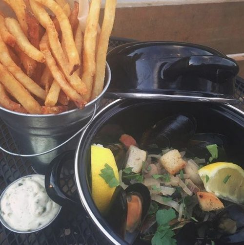 french fries, mussels, and aioli from the Cider House in Fairfield, Iowa. Photo credit: Cider House Instagram