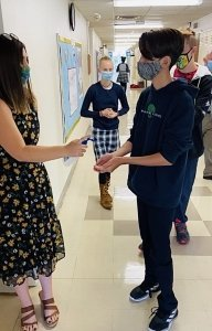 sanitize hands students 2020 coronavirus pandemic